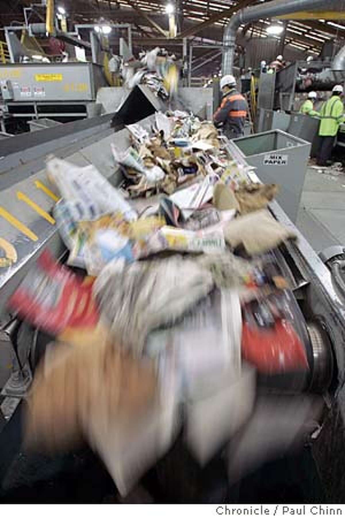 recycle31_048_pc.jpg Paper products of all types tumble through a sorting machine before it's wrapped into large bundles. The Sunset Scavenger recycling transfer station on 12/30/04 in San Francisco, CA. Over the ten day period after Christmas, Sunset Scavenger will process an additional 750 tons of recycling material. PAUL CHINN/The Chronicle MANDATORY CREDIT FOR PHOTOG AND S.F. CHRONICLE/ - MAGS OUT