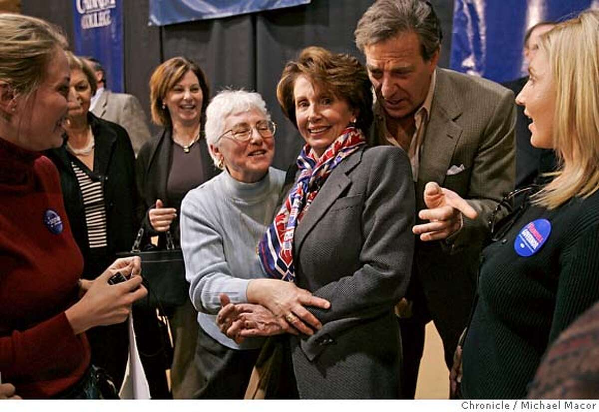 pelosi_246_mac.jpg Paul Pelosi leans into his wife Nancy as she poses for photographs with supporters a week before the November elections. Democratic Leader, Congresswoman Nancy Pelosi, D. San Francisco, makes a trip across the Southeastern section of Pennsylvania, on a