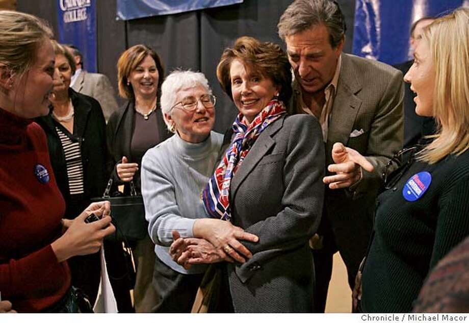 """pelosi_246_mac.jpg Paul Pelosi leans into his wife Nancy as she poses for photographs with supporters a week before the November elections. Democratic Leader, Congresswoman Nancy Pelosi, D. San Francisco, makes a trip across the Southeastern section of Pennsylvania, on a """"Get Out The Vote"""" campaign, stumping for local Democratic candidates. Event in, , Pa, on 11/4/06. Photo by: Michael Macor/ San Francisco Chronicle Mandatory credit for Photographer and San Francisco Chronicle / Magazines Out Photo: Michael Macor"""