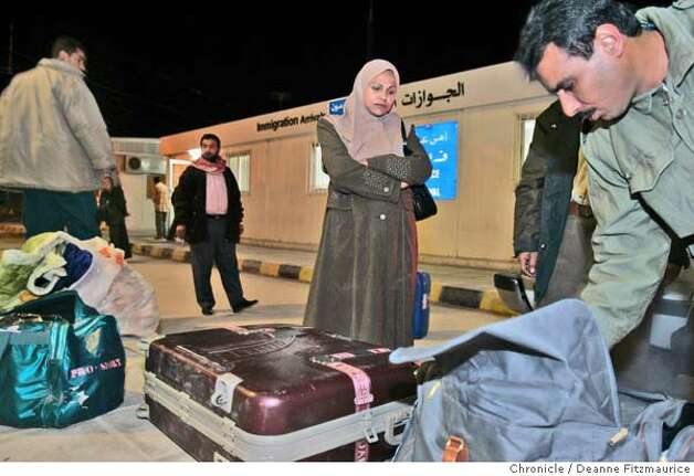 Hadia has her luggage searched as she crosses the border from Iraq into Jordan. Hadia Khanfoosh and her children flee Iraq and come to America to join her son, Saleh, and her husband, Raheem after being apart for over a year. Through an international medical intervention, Saleh Khalaf, 10, on the brink of death after a bomb explosion, was brought from Iraq to Oakland Children's Hospital along with his father, Raheem in November 2003. They were granted political asylum when it became unsafe for them to return to Iraq. Deanne Fitzmaurice / The Chronicle Photo: Deanne Fitzmaurice