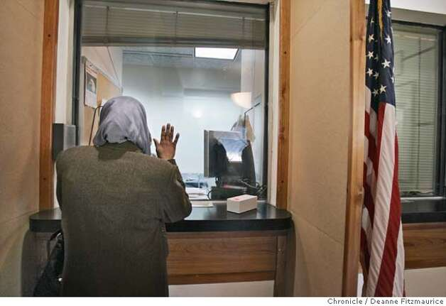 Hadia makes a pledge as she stands at the window of the U.S. Embassy in Amman, Jordan to get visas to go to the United States. Hadia Khanfoosh and her children flee Iraq and come to America to join her son, Saleh, and her husband, Raheem after being apart for over a year. Through an international medical intervention, Saleh Khalaf, 10, on the brink of death after a bomb explosion, was brought from Iraq to Oakland Children's Hospital along with his father, Raheem in November 2003. They were granted political asylum when it became unsafe for them to return to Iraq. Deanne Fitzmaurice / The Chronicle Photo: Deanne Fitzmaurice