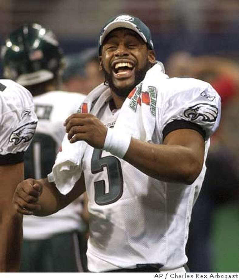 Philadelphia Eagles quarterback Donovan McNabb laughs on the sidelines after playing only two series against the St Louis Rams in St. Louis, Monday, Dec. 27, 2004. (AP Photo/Charles Rex Arbogast) Photo: CHARLES REX ARBOGAST