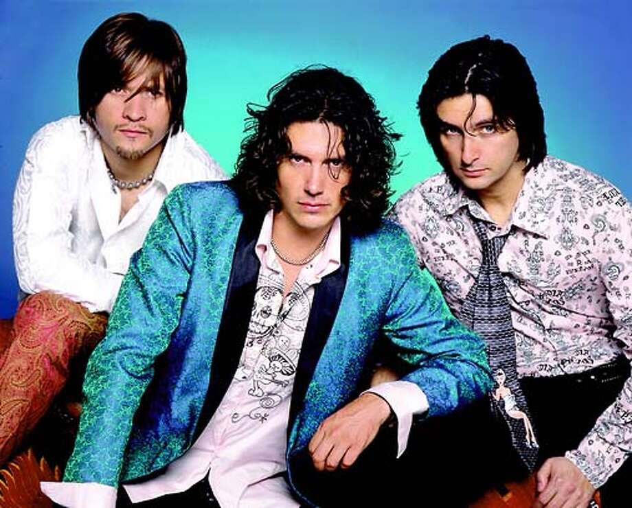 "The members of Jaguares are:Left: Cesar ""Vampiro"" Lopez (Guitar) Center: Saul Hernandez Right: Alfonso Andre (Drums)."