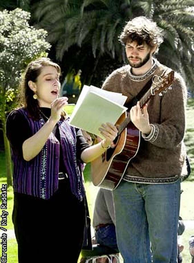 PHOTO BY KATY RADDATZ--THE CHRONICLE  Historic peace churches of San Francisco (Quaker Friends and Mennonite) invite the public to a service of public lament at the outbreak of warat Dolores Park. SHOWN: Lady singing is Pat Plude; guitar player is Norm Kaethler--they're practicing their hymns before singing with the crowd. Photo: Katy Raddatz