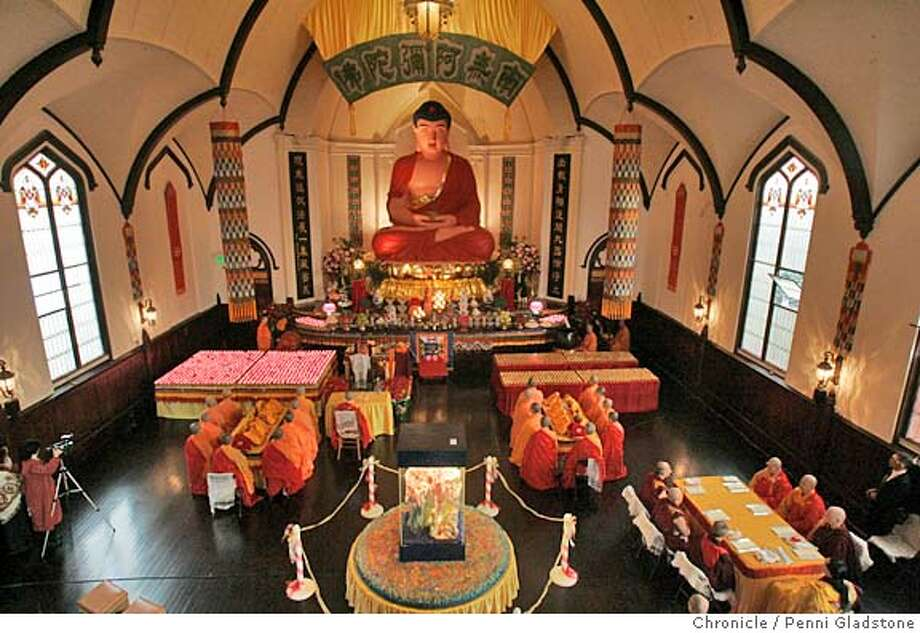MISSIONBUDDHA032PG.JPG  overview of the main room in the temple.  A Lutheran Church in the Mission District is home to the city's newest Buddhist temple, the Hua Zang Si. Today is the grand opening and marks the birthday of Amitabha Buddha. The San Francisco Chronicle, Penni Gladstone  Photo taken on 12/27/04, in San Francisco, CA. Photo: Penni Gladstone