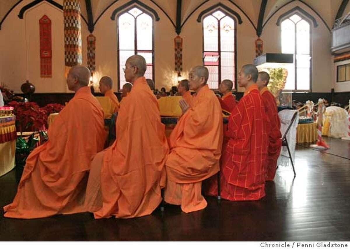 MISSIONBUDDHA042PG.JPG Desiples of the Buddah listen to chants. A Lutheran Church in the Mission District is home to the city's newest Buddhist temple, the Hua Zang Si. Today is the grand opening and marks the birthday of Amitabha Buddha. The San Francisco Chronicle, Penni Gladstone Photo taken on 12/27/04, in San Francisco, CA.