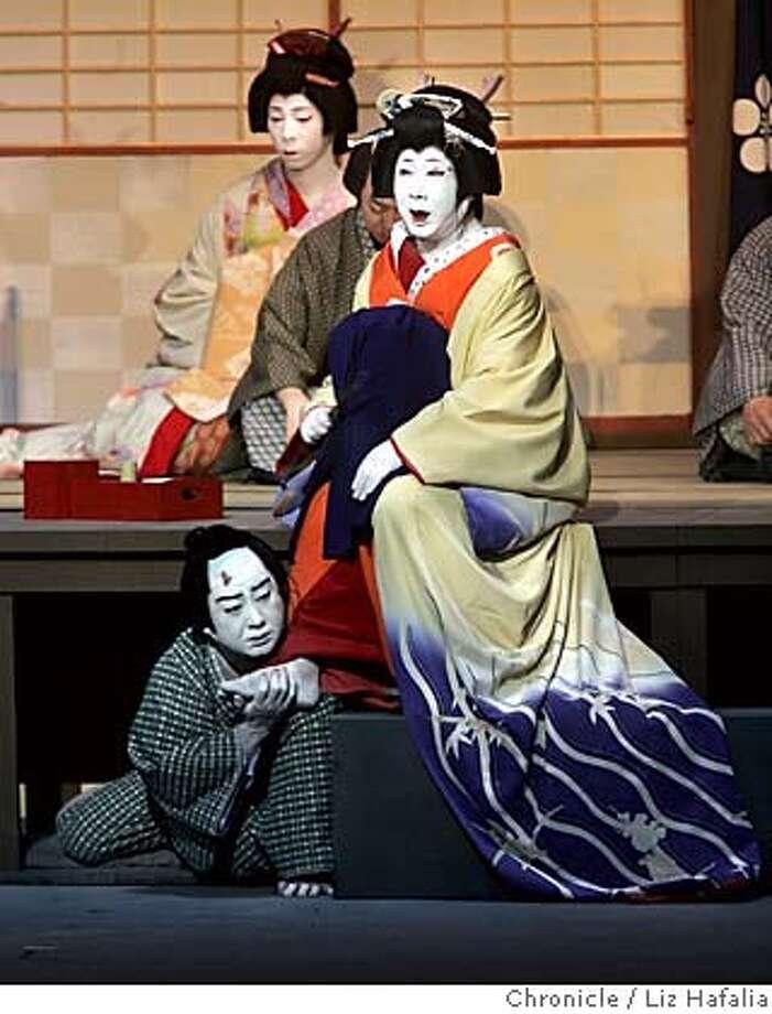 "KABUKI20_022_LH.JPG Opening night performance for Grand Kabuki Theatre of Japan in Cal Performances series at Zellerbach Hall which features the actual main Kabuki play ""Sonezaki Shinju"" , which featured Nakamura Ganjiro III as Ohatsu and Nakamura Kanjaku V (Ganjiro's son) as Tokubei. Behind them is Nakamura Ganshu (far back) as female shrine visitor, and Nakamura Kansai (back, middle) as Rokubei. Photographed by Liz Hafalia on 6/17/05 in Berkeley, {State Creditted to the San Francisco Chronicle/Liz Hafalia Photo: Liz Hafalia"