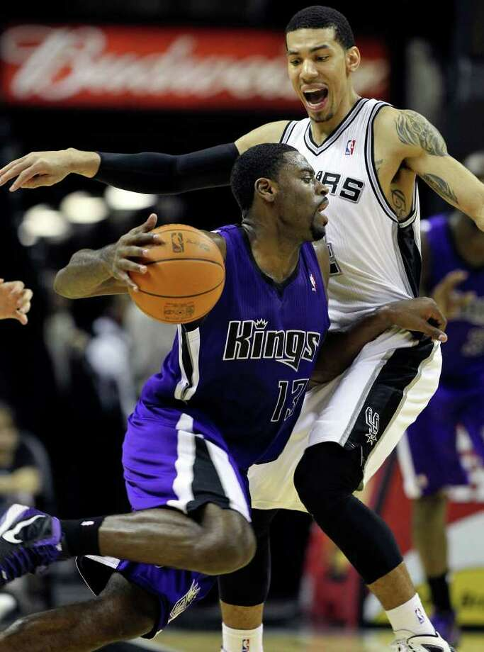 Danny Green gets in the way of Tyreke Evans as the Spurs play Sacramento at the AT&T Center in San Antonio on January 20, 2012 Tom Reel/ San Antonio Express-News Photo: TOM REEL, Express-News / © 2012 San Antonio Express-News  MAGS OUT; TV OUT; NO SALES; SAN ANTONIO OUT; AP MEMBERS ONLY; MANDATORY CREDIT; EFE OUT