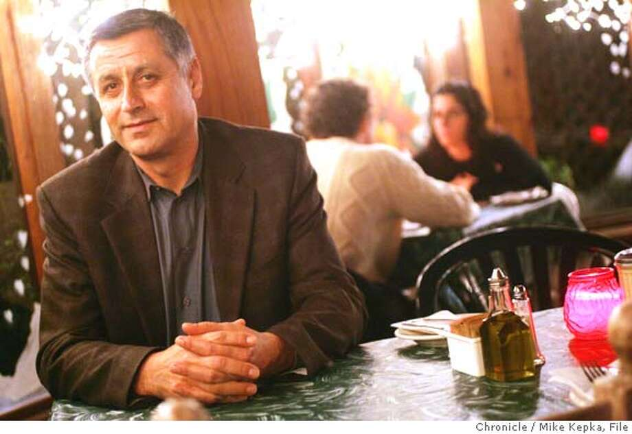 welat0029_mk.jpg Welat Yuksal has quietly hosted dinners for the homeless at his North Beach restaurant, Bocce, for aobut 5 years. 12/18/04  Mike Kepka/The Chronicle MANADATORY CREDIT FOR PHOTOG AND SF CHRONICLE/ -MAGS OUT Photo: Mike Kepka