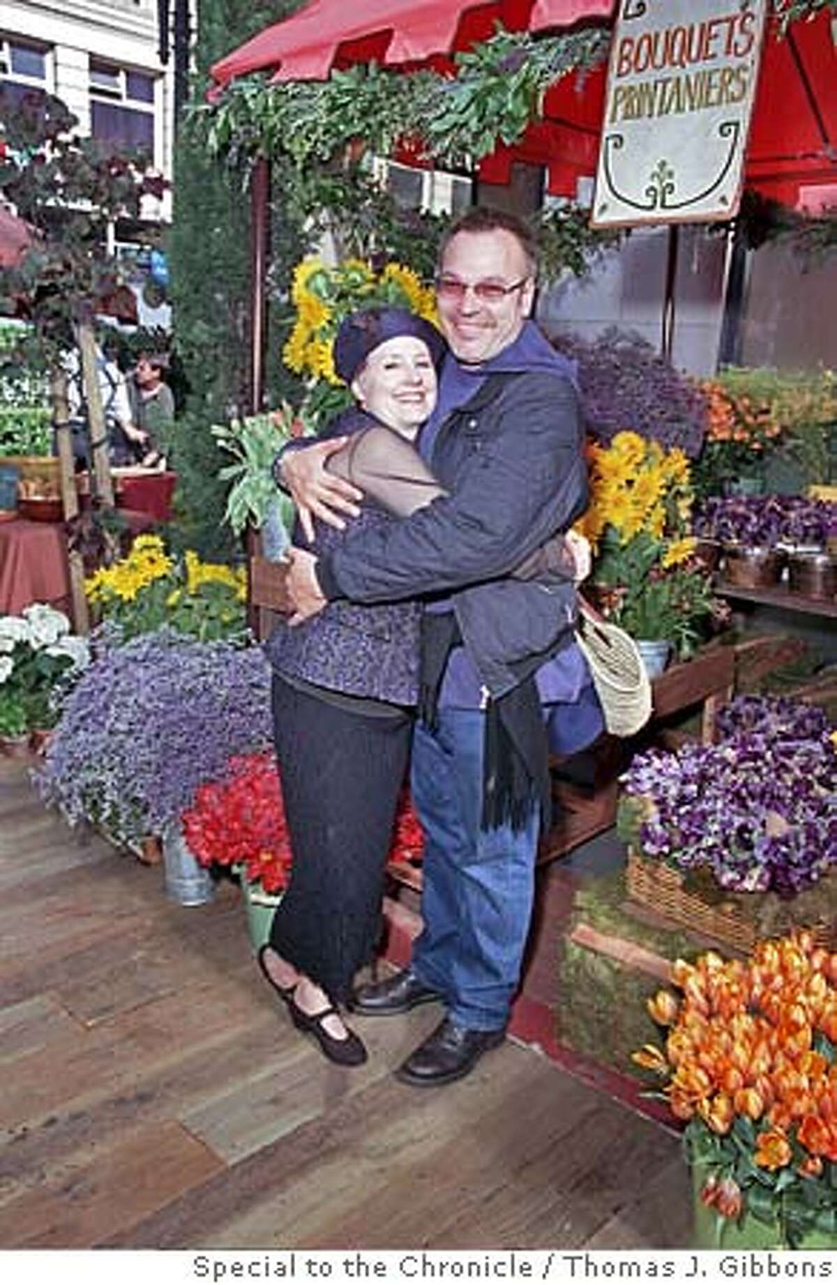 SOCIAL31 Alice Waters get a hug from Stanlee Gatti ( celebrating an appetite for life ) Special to the Chronicle/Thomas J. Gibbons Alice Waters gets a hug from Stanlee Gatti at the very-French Hermes opening in San Francisco. also ran 12/31/03 CAT