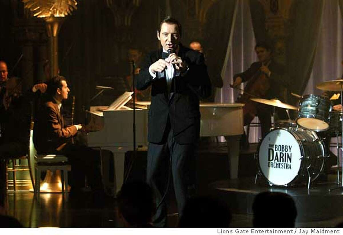 """In this photo provided by Lions Gate Entertainment, Kevin Spacey directs and stars as Bobby Darin in """"Beyond the Sea."""" (AP Photo/ Lions Gate Entertainment/Jay Maidment) Ran on: 12-26-2004 Bobby Darin died of heart disease in 1973. Ran on: 12-29-2004 Kevin Spaceys effort to portray Bobby Darin included singing the pop idols hits himself. Ran on: 12-29-2004 Mahmoud Abbas"""