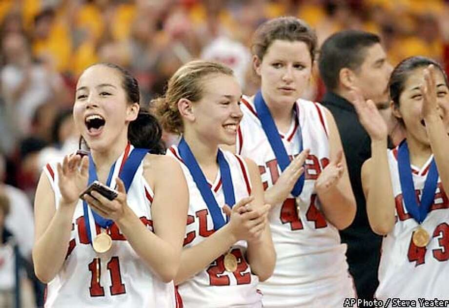 Convent of the Sacred Heart players, from left, Jen Hum-Traverso, Liz Brown, Kathy Catani and Stacey Fong celebrate their 68-59 victory over Mission College Prep in the CIF Division V championship game Friday, March 21, 2003, in Sacramento, Calif. (AP Photo/Steve Yeater) Photo: STEVE YEATER
