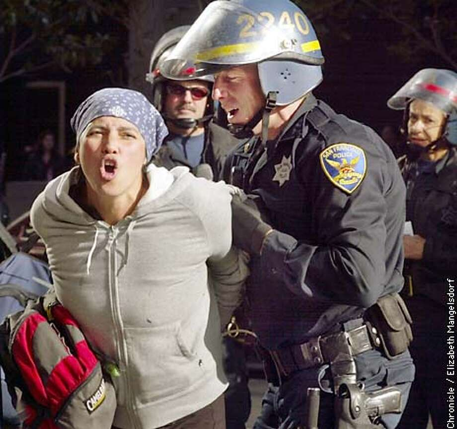 WARDEMO3-C-21MAR03-MT-LM  A protester is arrested by the police. She is part of the group of protesters that were arrested on Beale street at about 9am.  CHRONICLE PHOTO BY LIZ MANGELSDORF Photo: Liz Mangelsdorf
