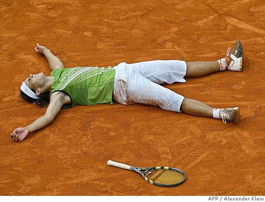 Spanish Rafael Nadal celebrates winning against Argentinian Mariano Puerta after their men's final match of the tennis French Open at Roland Garros, 05 June 2005 in Paris. Nadal won 6-7(6) 6-3 6-1 7-5. AFP PHOTO / ALEXANDER KLEIN (Photo credit should read ALEXANDER KLEIN/AFP/Getty Images) DV Photo: ALEXANDER KLEIN