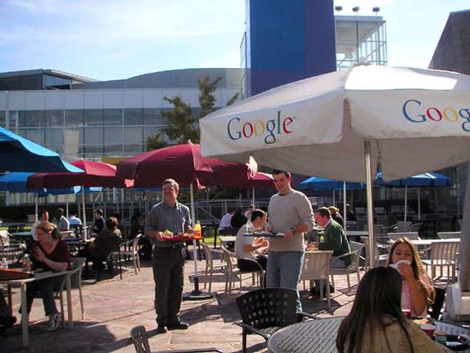 Diners relax at outside tables at Charlie's Place, the main cafe at Google. Photo: Cynthia Liu