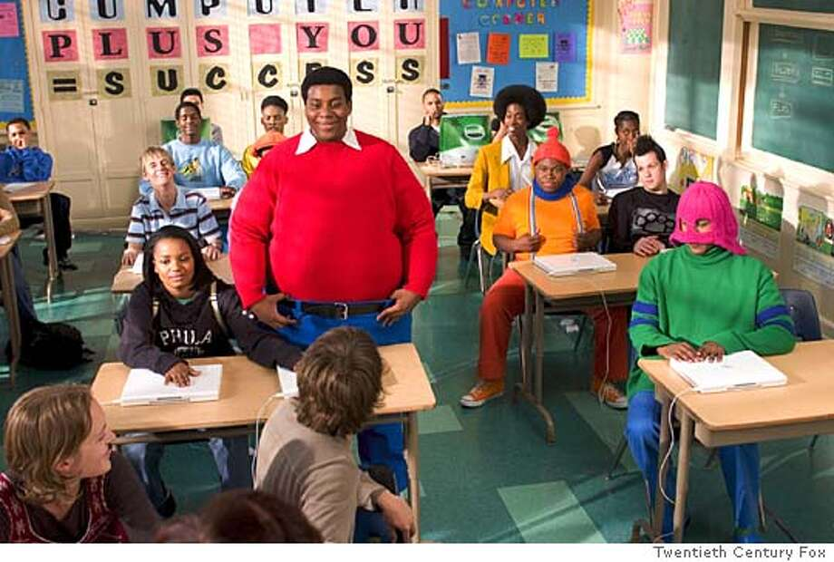 FAT25 Doris (Kyla Pratt, seated left) brings her new friends, Fat Albert (Kenan Thompson) and the Cosby Kids to class with her. Fat Albert�s pals are (back row, L-R) Bill (Keith D. Robinson), Bucky (Alphonso McAuley) and Old Weird Harold (Aaron A. Frazier). In the middle row are schoolmates played by Aaron Carter (L) and Joel Madden (R) seated beside Mushmouth (Jermaine Williams, center). Dumb Donald (Marques B. Houston) is seated in the front row on the right. Darren Michaels/Twentieth Century Fox