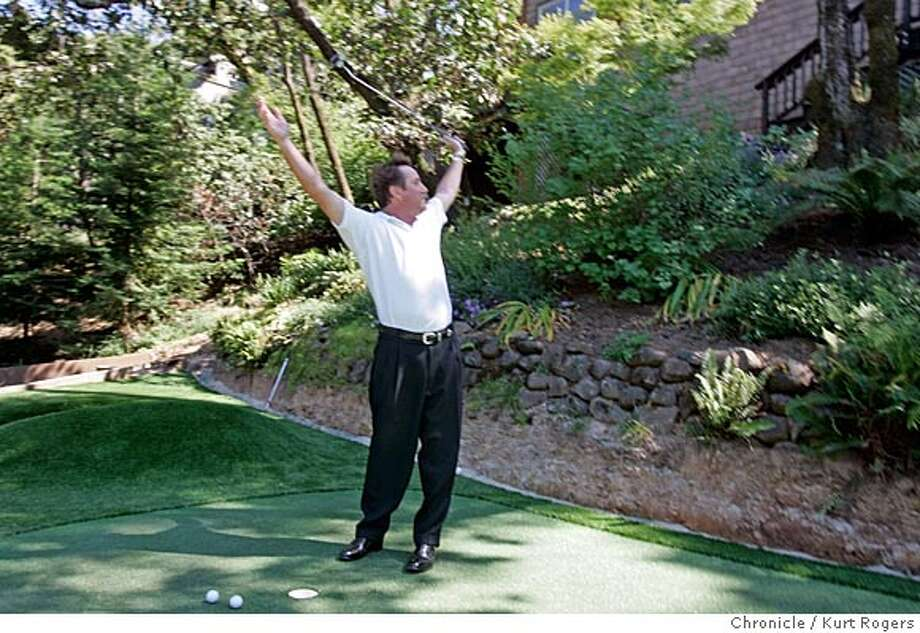 I was the only witness that Jack sunk his first put on the new green in his back yard.  Story is a feature (tied to U.S. Open/father's day weekend) on how advances in synthetic, at-home putting greens have made them a popular landscaping feature in the Bay Area. Jack Grandcolas is a 6 handicap at Marin Country Club who has this week been having a new green installed below his house on a San Rafael hillside. 6/7/05 in San Rafael,CA.  KURT ROGERS/THE CHRONICLE Photo: KURT ROGERS