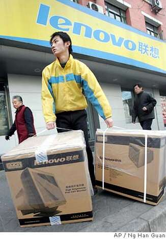A Chinese Lenovo worker carries boxes of computer monitors outside a Lenovo computer shop in Beijing, China, Wednesday, Dec. 8, 2004. China's biggest computer maker, Lenovo Group, said Wednesday it has acquired a majority stake in IBM Corp.'s personal computer business in a deal valued at US$1.75 billion (euro1.32 billion) _ one of the biggest Chinese overseas acquisitions ever. (AP Photo/Ng Han Guan) Photo: NG HAN GUAN