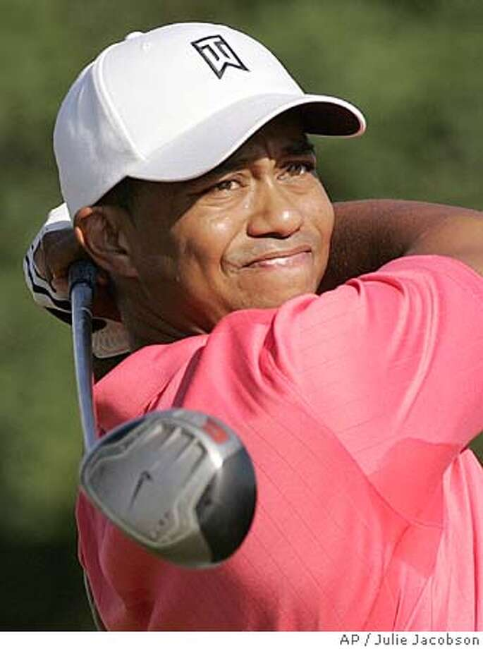 Tiger Woods watches his drive on the 13th hole during first round play in the 105th US Open Championship at the Pinehurst Resort and Country Club's No. 2 course in Pinehurst, N.C. Thursday, June 16, 2005. (AP Photo/Julie Jacobson) Photo: JULIE JACOBSON