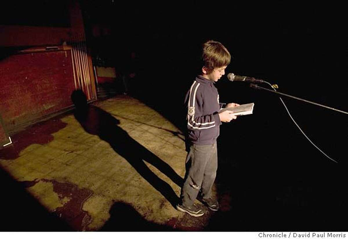 SAN FRANCISCO - DECEMBER 11: 7 year old Grant Black reads a peom he wrote at the Edinburgh Castle Pub as the Public House Press a new literary publishing group run by writers linked to the Edinburgh Castle celebrate the launch of it's first anthology at the Edinburgh Castle Pub in San Francisco on December 11, 2004. (Photo by David Paul Morris / The Chronicle