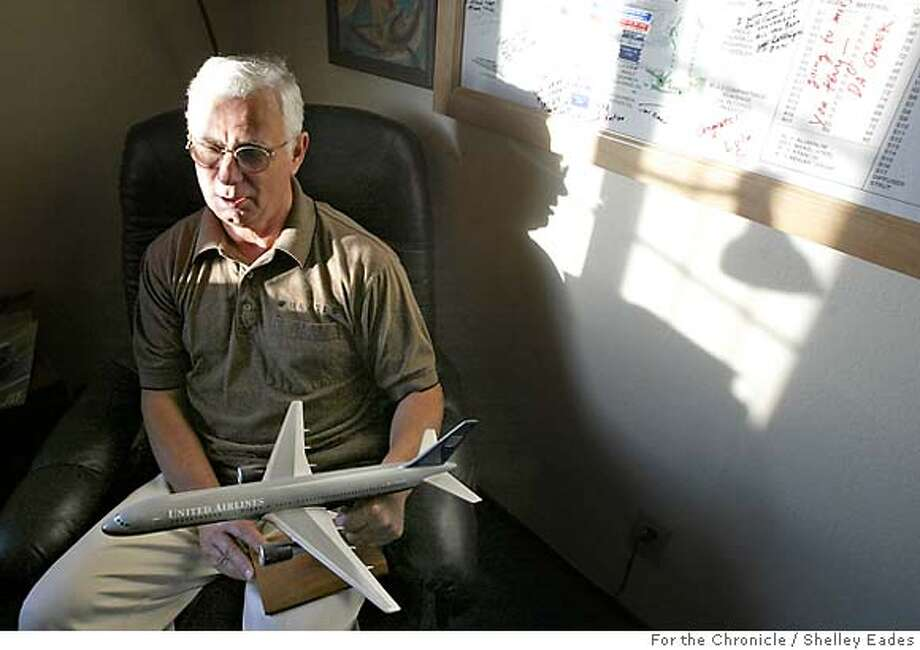 PENSION16 Terry Parsley holds the gift that his wife Judith gave him the day he retired from United, a model of the Boeing 757 plane whose engines he worked on as a lead engineer.  Terry and Judith Parsley retired from United Airlines in 2002 after working there for more than 30 years each. United's financial troubles could lead to a big cutback in their pension expectations. Event on (12/10/04) in (Benicia)  Photos by Shelley Eades/The Chronicle Photo: SHELLEY EADES