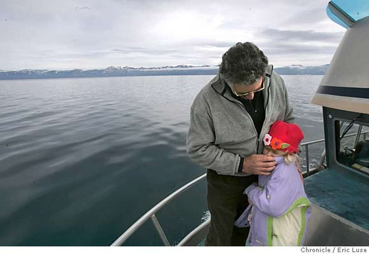 tahoe176_el.jpg UC Davis director Geoff Schladow of the Tahoe Environmental Rersearch Center warms up his daughter Gemma,7, on this cold winter day aboard the LeConte on Lake Tahoe. A new study by UC Davis scientists shows for the first time that the waters of Lake Tahoe are warming up at almost twice the rate of the world's oceans, probably as a consequence of global climate change. This change could have major implications for public plans to keep the lake blue. We will board the UC Davis research vessel John LeConte at its dock at the Tahoe City Marina, in Tahoe City, on the north shore. We will travel on the boat to offshore water-monitoring sites. We'll travel by boat out onto the lake and demonstrate how we measure lake water temperatures by lowering big thermometers into the water. We will visit a permanent buoy on the lake; it is bright yellow, with a background of the snowy mountains around the lake Event on 12/20/04 in Tahoe. Eric Luse / The Chronicle