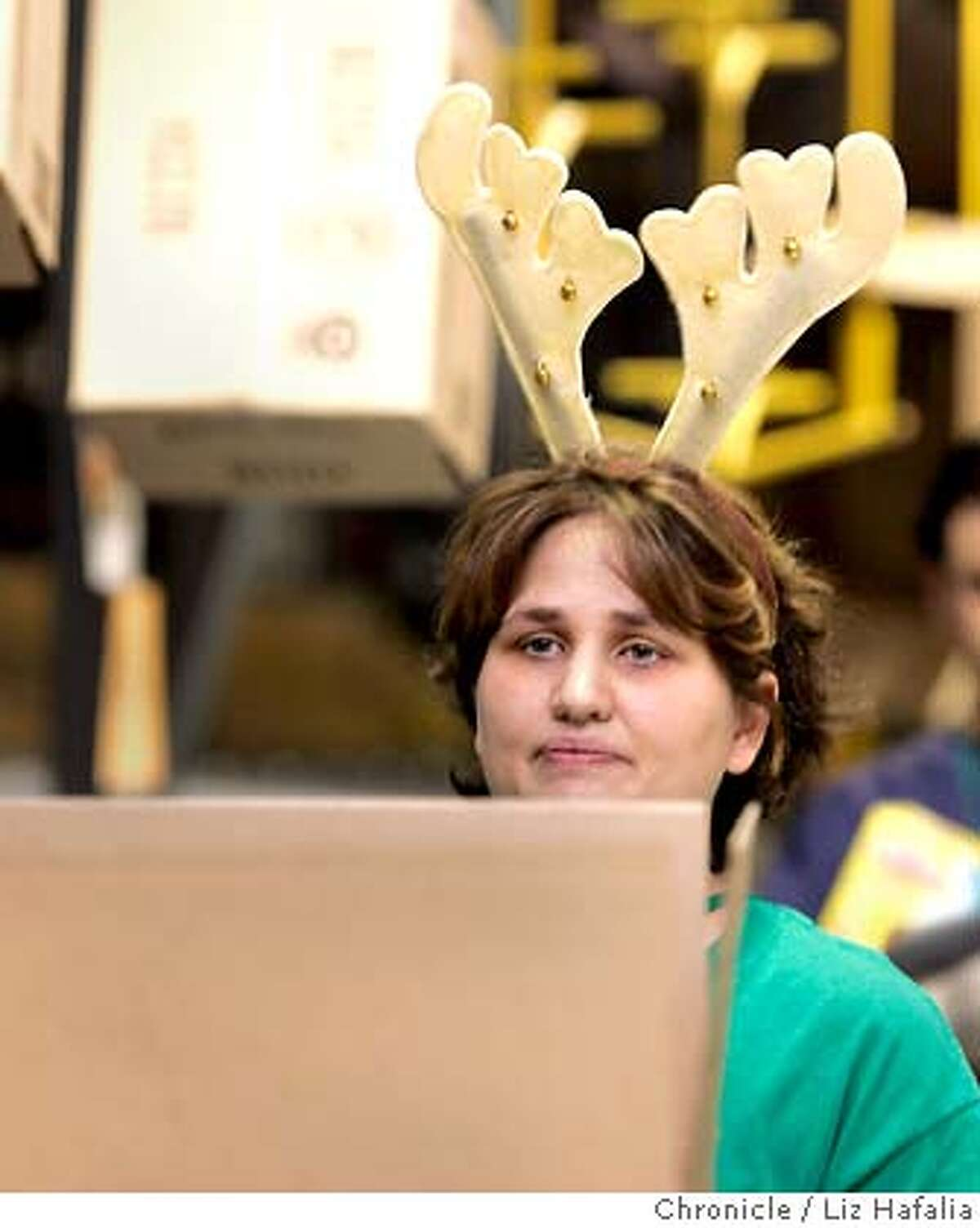 The Amazon.com distribution center in Fernley, NV, during its peak hoilday shopping season. Julie Gerbeler waiting for merchandise to box . Shot on 12/15/04 in Fernley. LIZ HAFALIA/The Chronicle