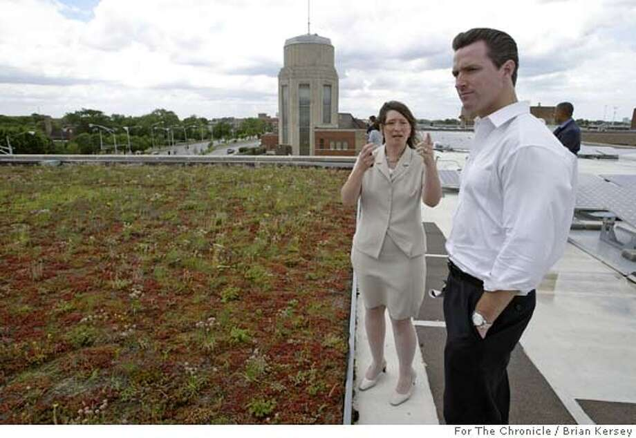 """San Francisco Mayor Gavin Newsom, right, is shown a """"green"""" roof by Grace Troccolo, an assistant commissioner in the City of Chicago's Department of Environment, Tuesday, June 14, 2005, in Chicago. Photo by Brian Kersey/For The Chronicle Photo: Brian Kersey/For The Chronicle"""