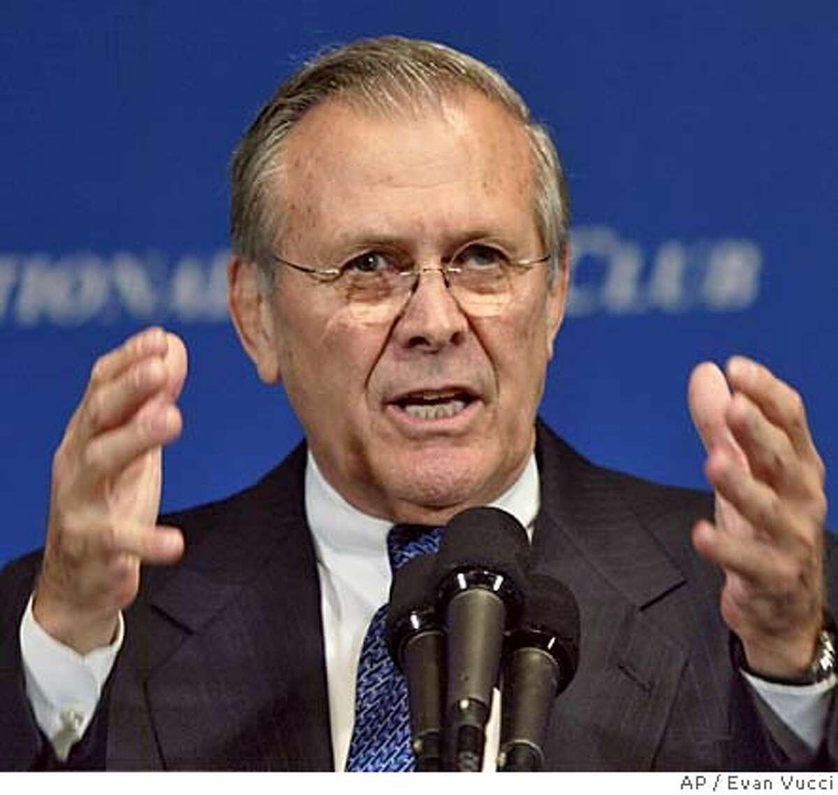 Secretary of Defense Donald Rumsfeld gestures during a speech at the National Press Club on Friday, Sept. 10, 2004 in Washington. Rumsfeld discussed the global war on terrorism. (AP Photo/Evan Vucci) Ran on: 09-11-2004 Donald Rumsfeld Ran on: 09-11-2004 Donald Rumsfeld Ran on: 09-11-2004 Donald Rumsfeld