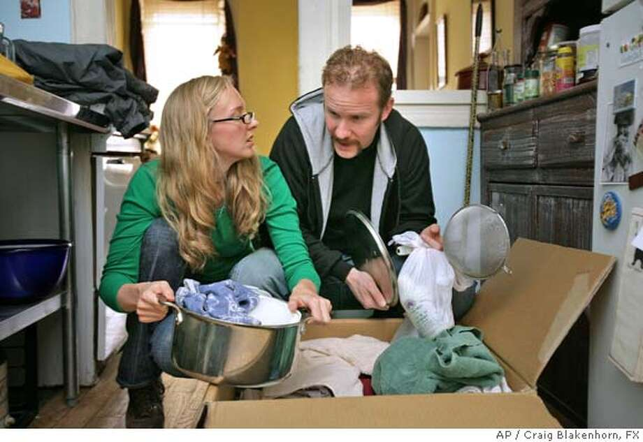 "**ADVANCE FOR WEEKEND EDITIONS JUNE 11-12, WITH TV LOOKOUT**This undated photo supplied by the FX Network shows Morgan Spurlock and his fiancee Alexandra Jamieson in the first episode of a six-week reality series ""30 Days,"" which premieres Wednesday night June 15, 2005. In the opener of the FX series they set up housekeeping, land minimum-wage jobs, and struggle to get by while trying to live on the minimum wage -- $5.15 an hour --for 30 days in a Columbus, Ohio, apartment. Spurlock, a filmmaker whose hit 2004 documentary ""Super Size Me"" chronicled his monthlong McDonald's-only diet, also hosts the other episodes on the 30-day struggle of other participants. (AP Photo/FX,Craig Blakenhorn)  Craig Blakenhorn, FX , UNDATED,ADVANCE FOR WEEKEND EDITIONS JUNE 11-12, WITH TV LOOKOUT Photo: CRAIG BLAKENHORN"