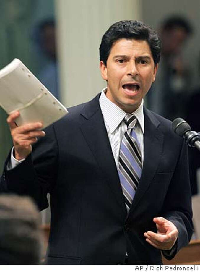 Assembly Speaker Fabian Nunez, D-Los Angeles, holds up copy of the budget bill as he urges Assembly members for it's passage during the legislative session held at the Capitol in Sacramento, Wednesday, June 15, 2005. By a 46-32 vote, the Assembly failed to get the two-thirds votes need to pass 2005-06 state spending plan. Lawmakers have until midnight Wednesday to approve a state budget in order to met a constitutional deadline, that has not been met in the past 18 years.(AP Photo/Rich Pedroncelli) Photo: RICH PEDRONCELLI