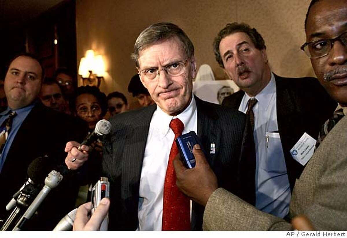 Major League Baseball Commissioner Bud Selig talks to the media after speaking at the Greater Washington Board of Trade luncheon in Washington Thursday, Dec. 2, 2004. (AP Photo/Gerald Herbert)