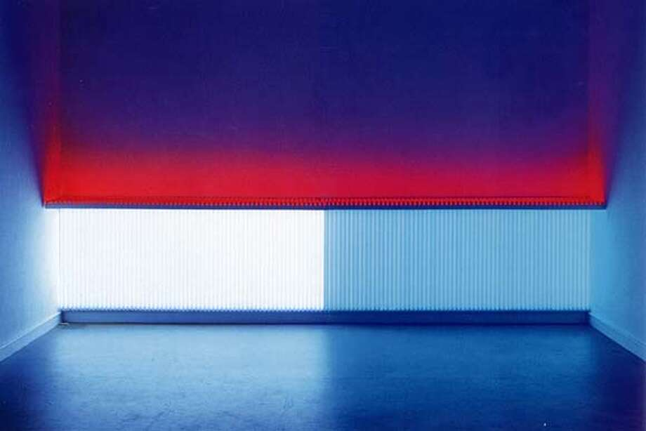 """Untitled"" (1969): daylight and red flourecent light. 46'x2'.  Dan Flavin."