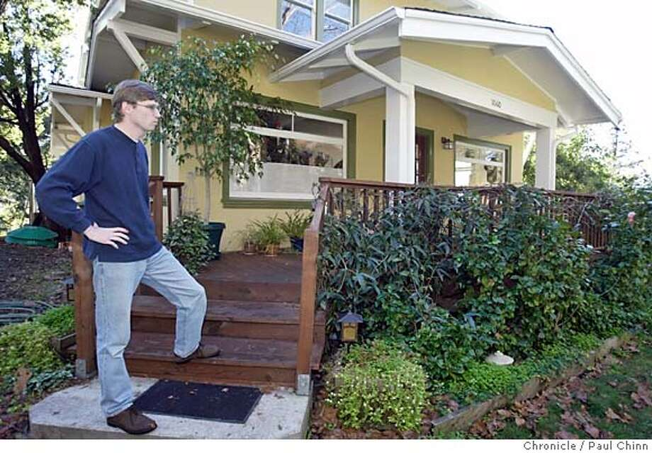Keith Avenue homeowner Robert Mathews says the sliding earth has resulted in continual leaks in the water main in front of his house. Gradual slides near Euclid and Keith Aves. in the hills are slowly pushing homes across neighboring property lines on 12/15/04 in Berkeley, CA.  PAUL CHINN/The Chronicle Photo: PAUL CHINN