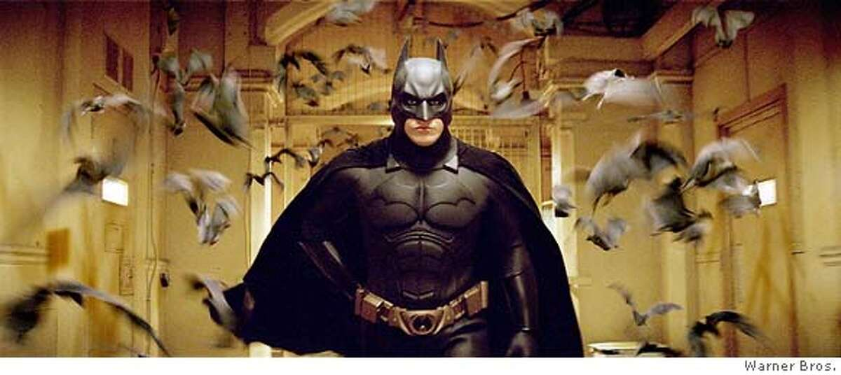 Actor Christian Bale, shown in this undated publicity photograph, stars as Batman in a scene from Warner Bros. Pictures' action adventure film