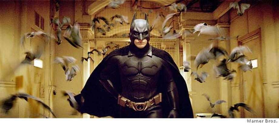 "Actor Christian Bale, shown in this undated publicity photograph, stars as Batman in a scene from Warner Bros. Pictures' action adventure film ""Batman Begins"" which opens in the United States on June 15, 2005. NO ARCHIVES NO THIRD PARTY SALES Warner Bros./Handout 0 Photo: HO"