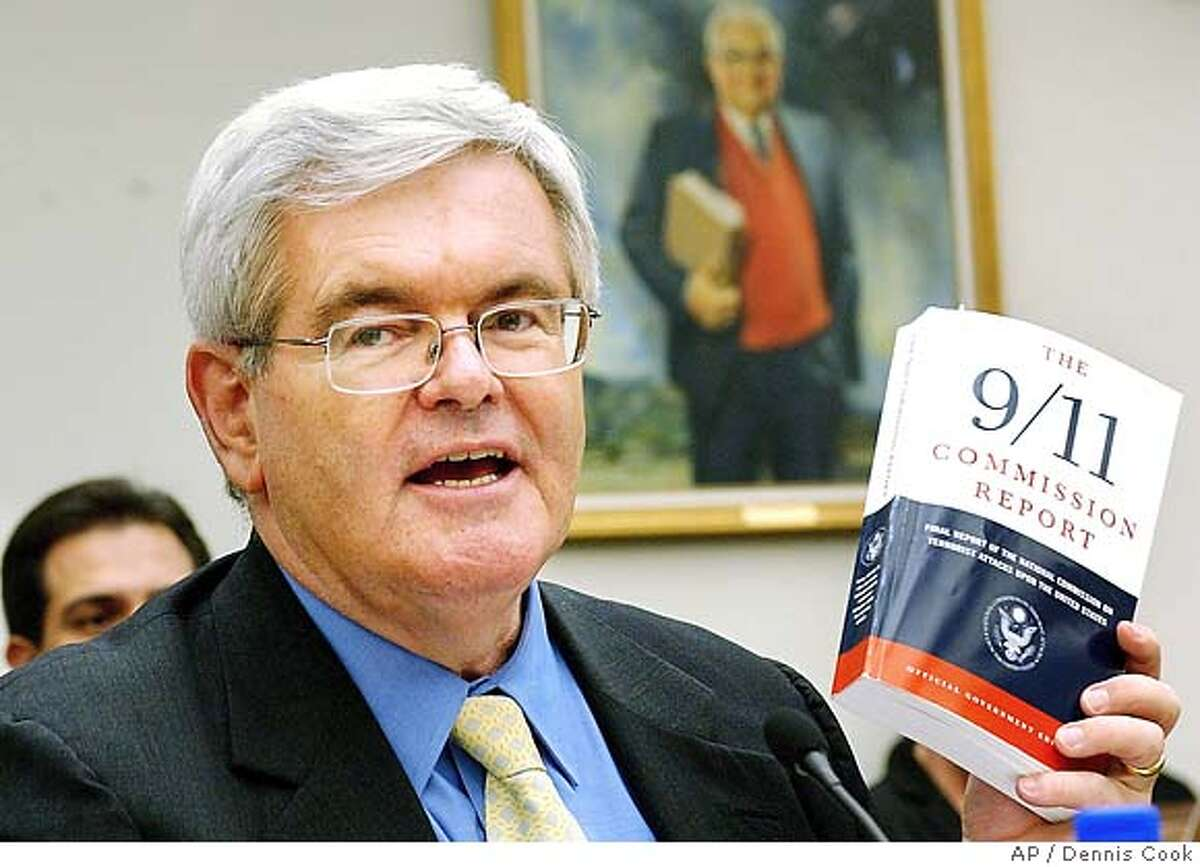** FILE ** Former Speaker of the House Newt Gingrich holds up the 9/11 Commission Report as testifies before the House Select Committee on Intelligence on Capitol Hill in this Aug. 11, 2004 file photo. Gingrich takes a step towards a possible 2008 presidential bid with the publication of a new book criticizing Bush administration Iraq policies.