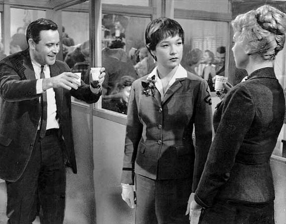 "(L-R) Jack Lemmon, Shirley MacLaine and Edie Adams in the holiday office party scene from the movie ""The Apartment""  HANDOUT"