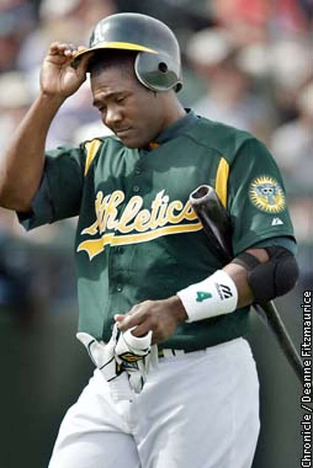 Miguel Tejada returns to the dugout as the Oakland Athletics play the Arizona Diamondbacks at spring training in Phoenix, Arizona.  CHRONICLE PHOTO BY DEANNE FITZMAURICE Photo: Deanne Fitzmaurice