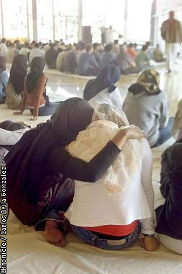 Two muslims women hold each other during a prayer service at University of California Berkeley on Friday, September 14, 2001, where the muslim community urged calm in the wake of the worst terrorist action in U.S. history. (Photo by Carlos Avila Gonzalez/The San Francisco Chronicle) Photo: CARLOS AVILA GONZALEZ