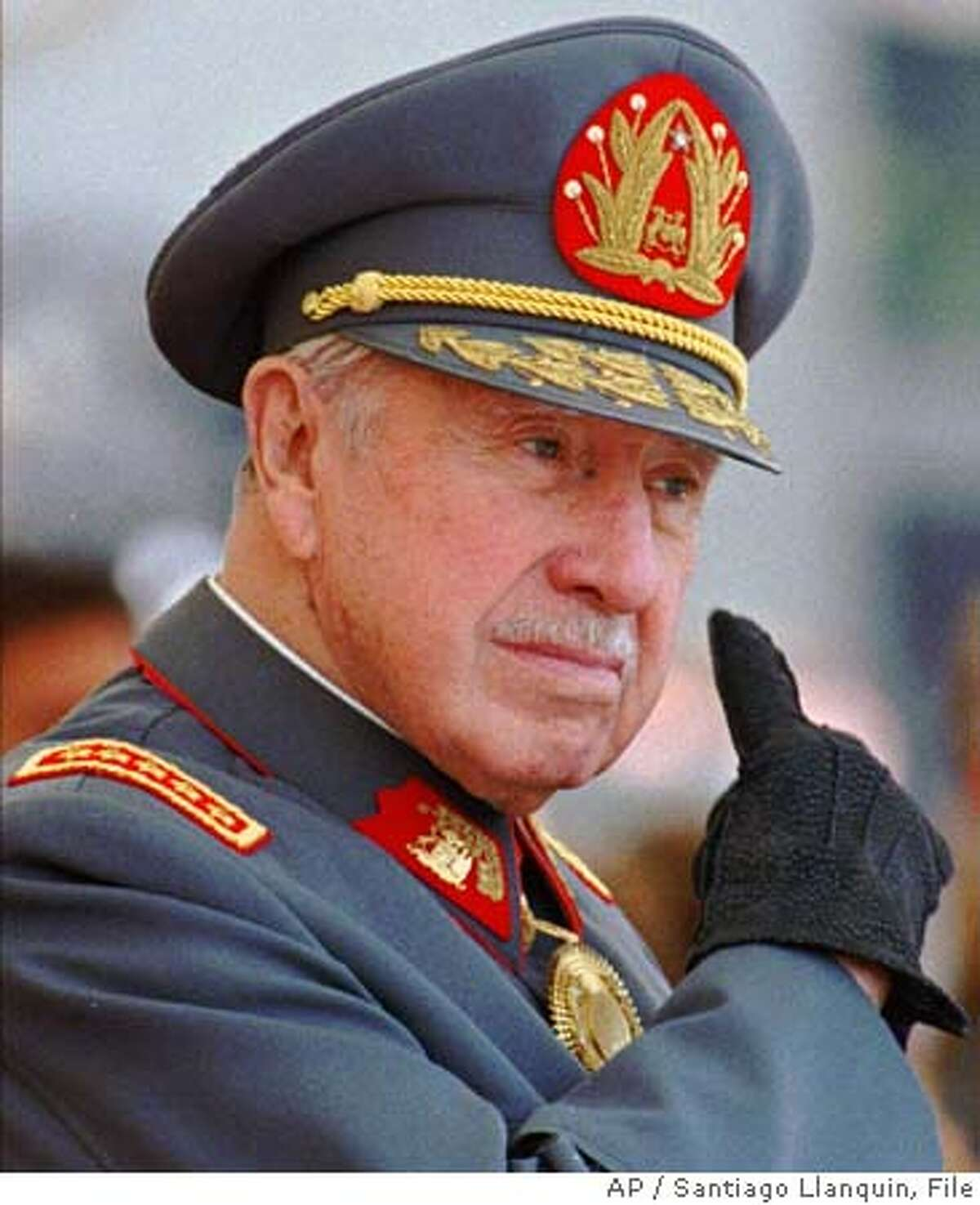 ** FILE ** Former dictator Gen. Augusto Pinochet is seen in Santiago, Chile in this this Sept. 11, 1997 file photo. In this Sept. 11, 1997 file photo. Gen. Augusto Pinochet suffered a stroke, but is in stable condition at Santiago's Army Hospital Saturday, Dec. 18, 2004 hospital officials said. (AP Photo/Santiago Llanquin, FILE)