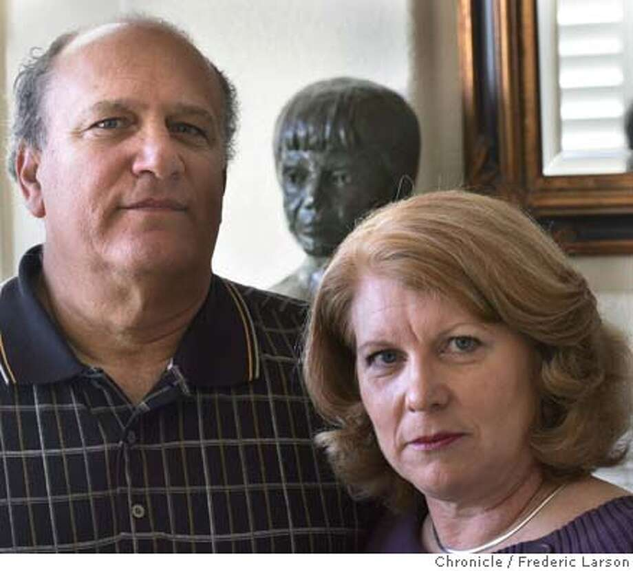STEROIDS_102_fl.jpg Denise and Ray Garibaldi of Petaluma lost their son Rob (Rob busted in background) who was a top-level prospect for professional baseball but spiraled amid use of steroids. 11/22/04 Petaluma CA Frederic Larson  The San Francisco Chronicle Photo: Frederic Larson