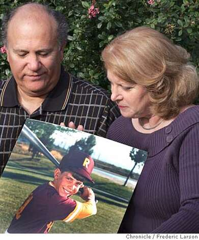 STEROIDS_058_fl.jpg Denise and Ray Garibaldi of Petaluma lost their son Rob (holding of photo of Rob at the age of 9) who was a top-level prospect for professional baseball but spiraled amid use of steroids. 11/22/04 Petaluma CA Frederic Larson  The San Francisco Chronicle Photo: Frederic Larson