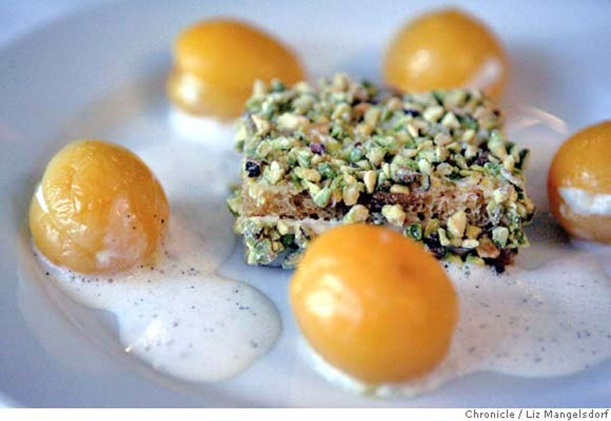 Event on 5/25/05 in San Francisco. The new restaurant Canteen on Sutter Street, with chef Dennis Leary. Here is a dessert of stewed apricots with pistachio cake and vanilla cream. Liz Mangelsdorf / The Chronicle