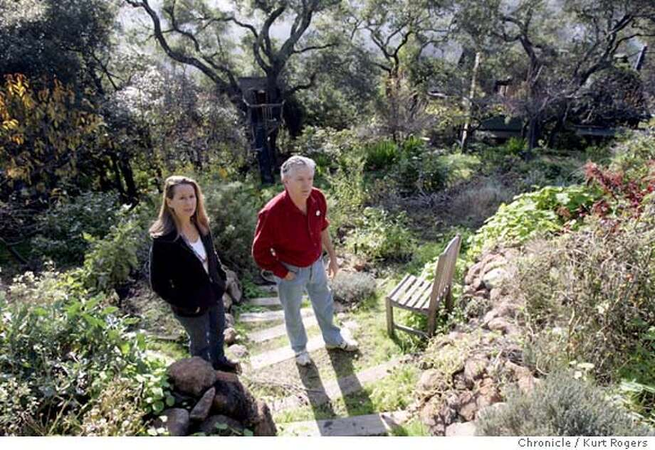 Marine Environmental duo Randy Hayes and his wife Lauren Klein Hayes. in the back yard of their Mill Valley home . He was a founder of Rainforest Action Network, which muscles big companies into changing their enviro policies and practices. She's the co-director of Don't Be Fueled, which is pushing the auto industry to make more hybrid cars. She's also been on the boards and committees of several other enviro groups and foundations 12/11/04 in Mill Valley ,CA.  KURT ROGERS/THE CHRONICLE Photo: KURT ROGERS