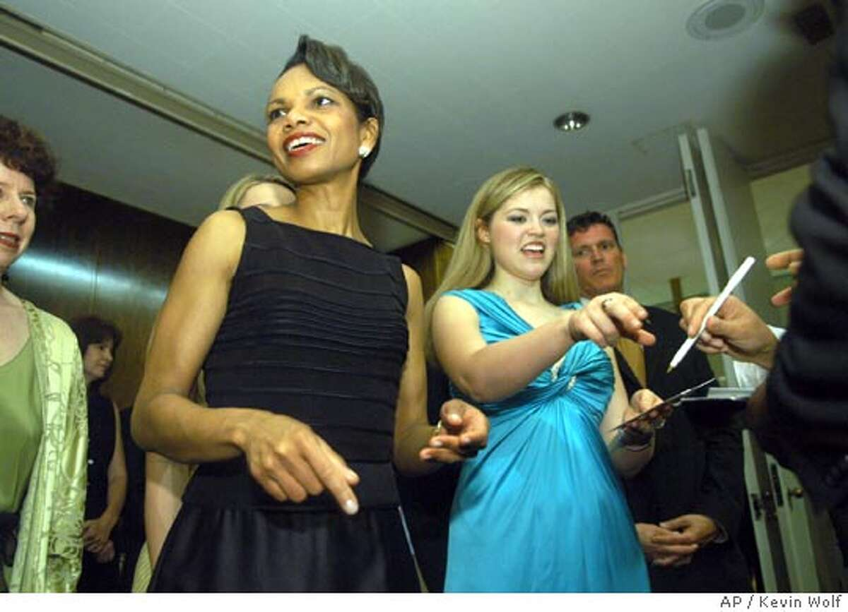 Secretary of State Condoleezza Rice and Charity Sunshine sign autographs after they preformed at a concert in the Kennedy Center in Washington, Saturday, June 11, 2005. (AP Photo/Kevin Wolf)