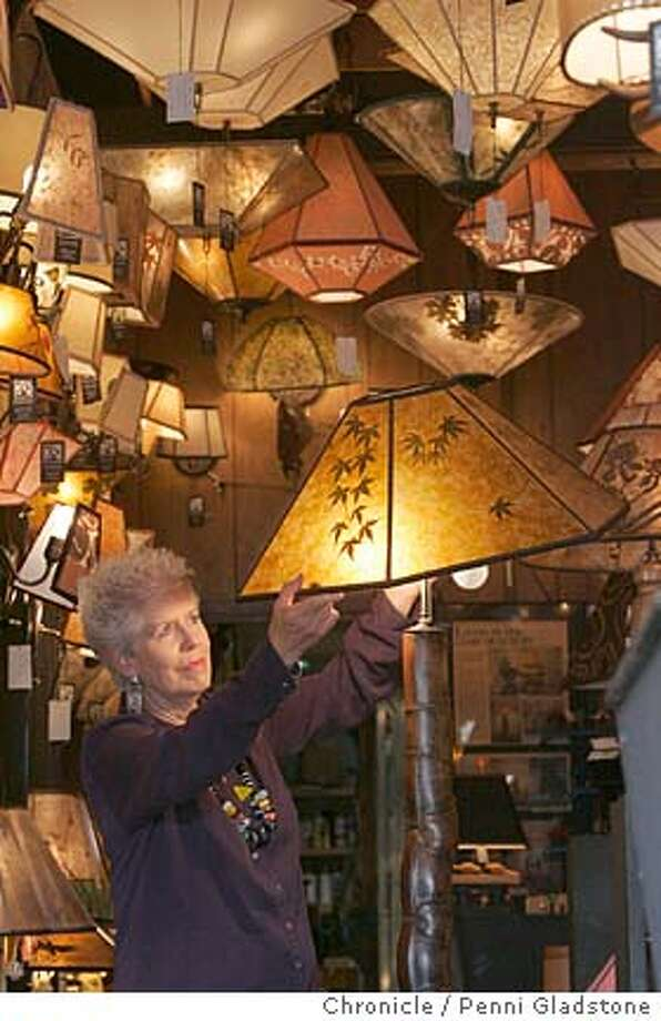 SUEJOHNSON094PG.JPG  WITH A lampbase made of one piece of unusual bamboo  SUE JOHNSON hand makes lamps and shades with her staff.  The San Francisco Chronicle  Photo taken on 12/7/04, in Albany, CA. Photo: Penni Gladstone