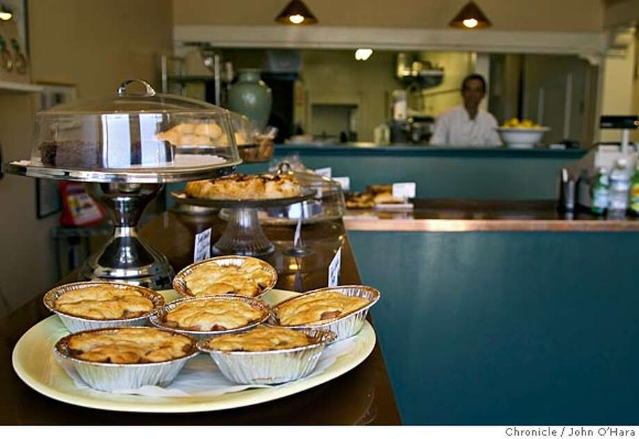 "LOLA'S TAKE OUT FOOD. 1585 Solano Ave. Berkeley, CA.  John Janacheck in his resturant where food is prepared ""to go"" and specialty deserts. Photo/John O'Hara Photo: John O'Hara"