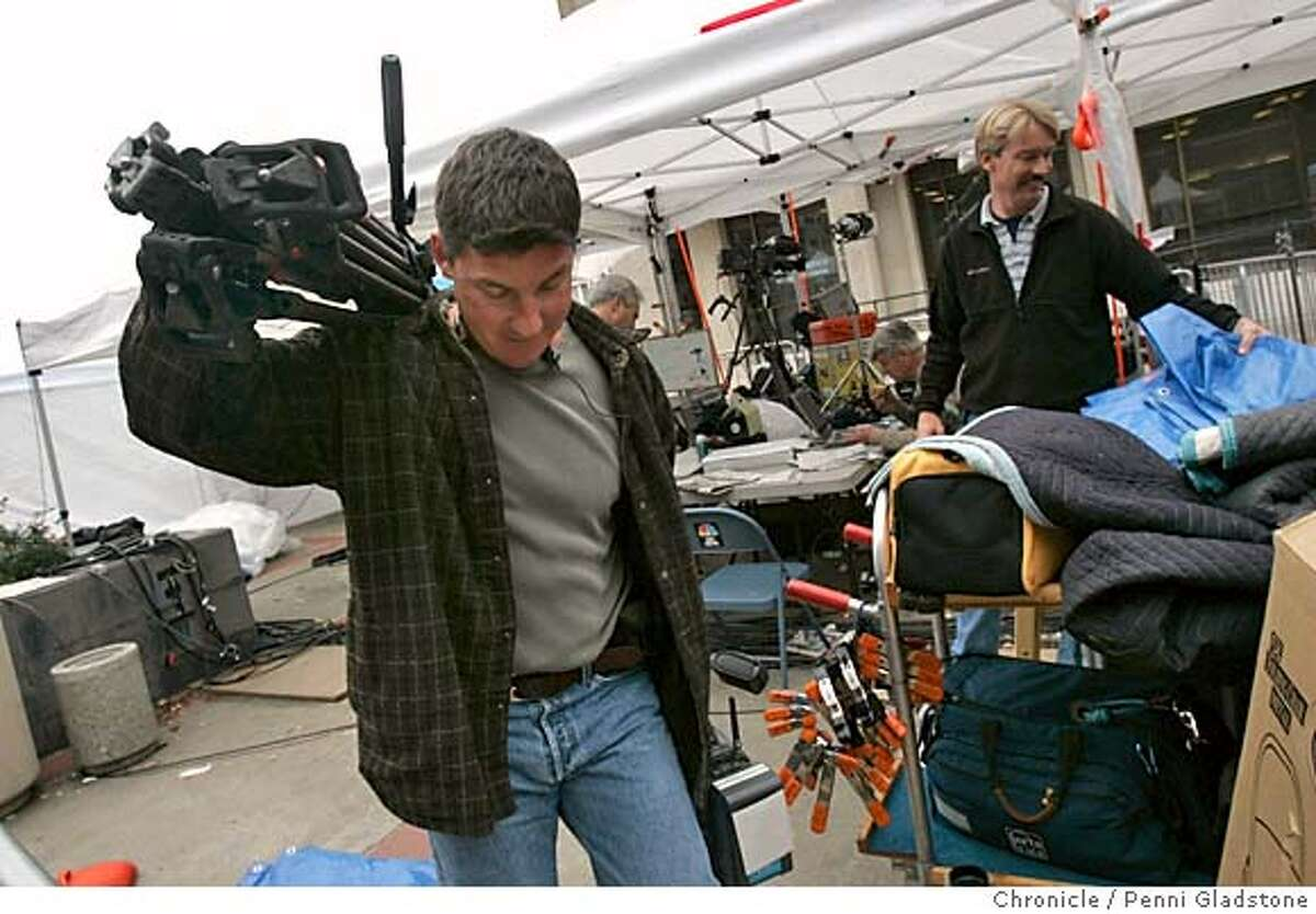 PETERSON15065PG.JPG Dean Smith, a photographer with NBC11 clears his gear from this spot under the tent (no ident of person at rt) Redwood City-cleans-up story after the. Peterson trial The San Francisco Chronicle, Penni Gladstone Photo taken on 12/15/04, in Redwood City, CA.