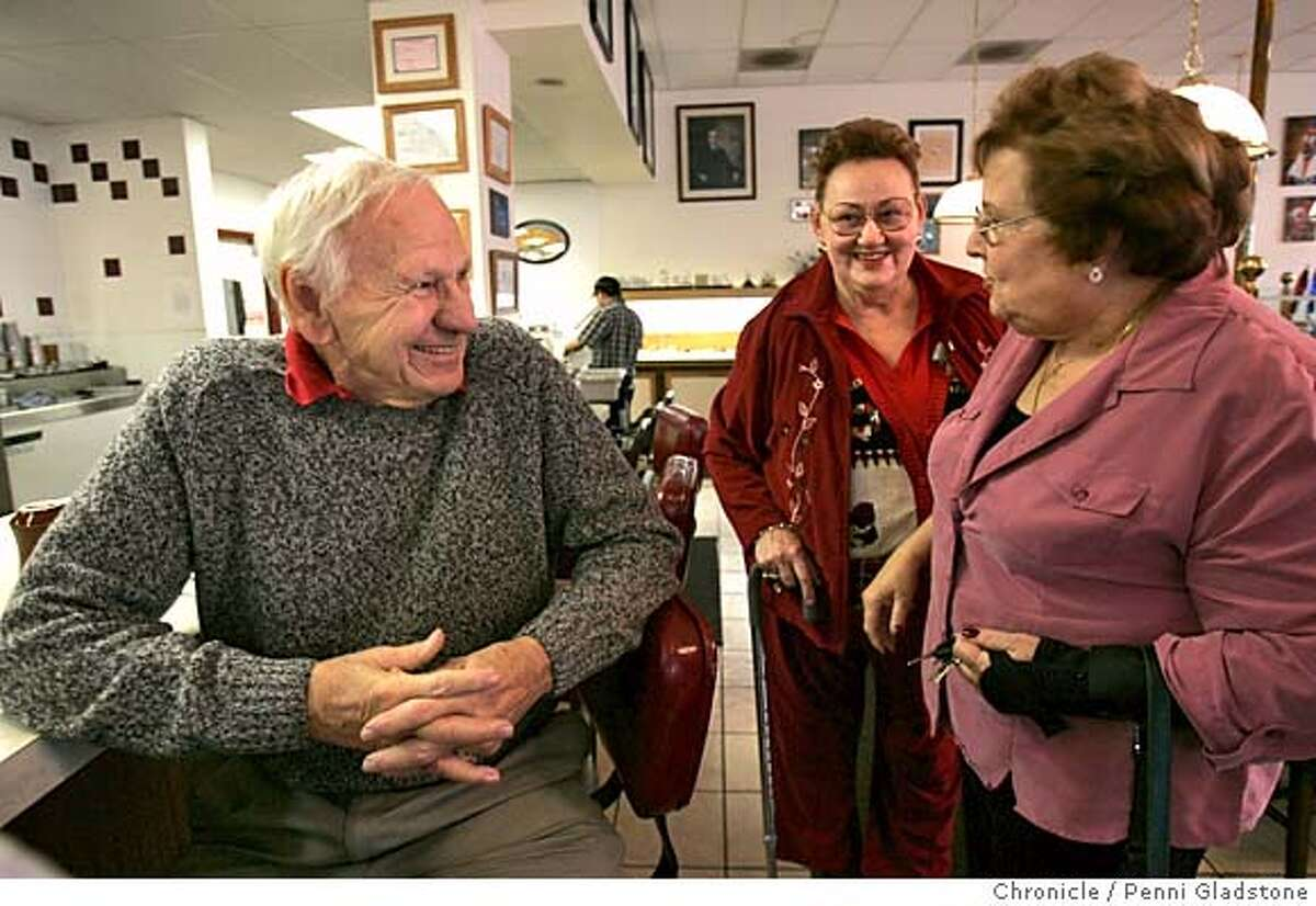 PETERSON15097PG.JPG Bob Bryant owner of this diner at left,in center is customer, Anita Lollar of R.C. Bob talks with long time customer, Lenora Barnatt, at rt, from Santa Cruz who used to eat here every week when she lived in R.C. Redwood City-cleans-up story after the Peterson trial The San Francisco Chronicle, Penni Gladstone Photo taken on 12/15/04, in Redwood City, CA.